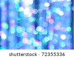 Abstract festive background of blurred lights - stock photo