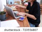 business  woman holding digital ... | Shutterstock . vector #723556807