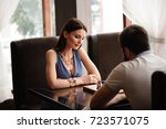 man and woman playing chess | Shutterstock . vector #723571075