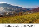 grassy hillside over the... | Shutterstock . vector #723597817