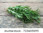 rosemary bound on a wooden board | Shutterstock . vector #723605095