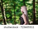 handsome blonde girl surrounded ... | Shutterstock . vector #723605311