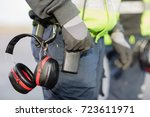 midsection of worker with ear... | Shutterstock . vector #723611971