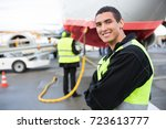 confident male worker smiling... | Shutterstock . vector #723613777