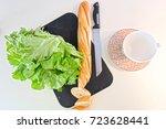 lettuce  bread and knife | Shutterstock . vector #723628441