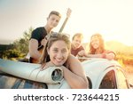 group of happy people in a car... | Shutterstock . vector #723644215