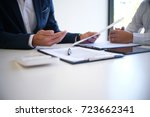 sales manager giving advice... | Shutterstock . vector #723662341