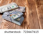 money isolated on a wooden... | Shutterstock . vector #723667615