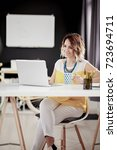 businesswoman using laptop and... | Shutterstock . vector #723694711