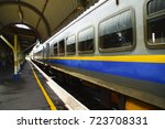 train arriving at train station | Shutterstock . vector #723708331