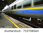 train arriving at train station | Shutterstock . vector #723708364