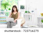 young woman with laptop in... | Shutterstock . vector #723716275