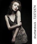 fashion girl posing on dark... | Shutterstock . vector #72372574