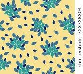 blue flowers on a light yellow... | Shutterstock .eps vector #723738304