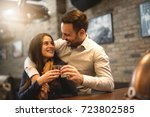 happy couple drinks alcohol at... | Shutterstock . vector #723802585