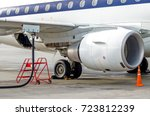 fueling aircraft  view of the... | Shutterstock . vector #723812239