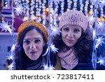 friends enjoying christmas... | Shutterstock . vector #723817411