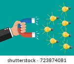 hand of businessman with magnet ... | Shutterstock .eps vector #723874081
