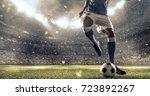 soccer player kicks the ball on ... | Shutterstock . vector #723892267