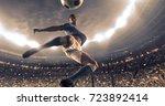 soccer player kicks the ball on ...   Shutterstock . vector #723892414