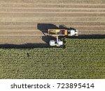 machines harvesting corn in the ... | Shutterstock . vector #723895414