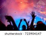 silhouette of raised hands on... | Shutterstock . vector #723904147