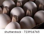 white eggs in carton box .... | Shutterstock . vector #723916765