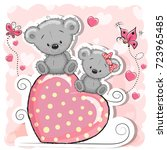 two teddy bears is sitting on a ... | Shutterstock .eps vector #723965485