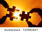 two hands trying to connect... | Shutterstock . vector #723981847