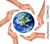 Hands around the world in signal of protection and conservation
