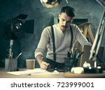architect working on drawing... | Shutterstock . vector #723999001