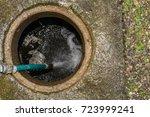water drain on street | Shutterstock . vector #723999241