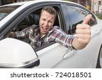 nice men with his brand new car | Shutterstock . vector #724018501