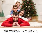 happy young family lying... | Shutterstock . vector #724035721