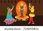 couple playing dandiya raas in...   Shutterstock .eps vector #724055821