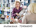 friendly seller helps customers ... | Shutterstock . vector #724066045