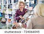 friendly seller helps customers ... | Shutterstock . vector #724066045