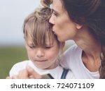 mom kissing preschooler girl.... | Shutterstock . vector #724071109