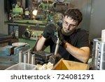 worker make something at plant | Shutterstock . vector #724081291