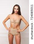 beautiful woman in beige...   Shutterstock . vector #724085011