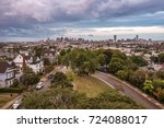 Small photo of Somerville, USA - September 14 2017: The skyline of downtown Boston as seen from the Prospect Hill Tower in Somerville during unsettled weather just before sunset.