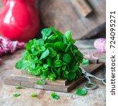 bunch of fresh mint on rustic... | Shutterstock . vector #724095271