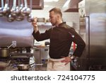 food concept. a young cook... | Shutterstock . vector #724104775