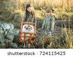the children on the harvest of... | Shutterstock . vector #724115425