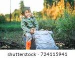 the children on the harvest of... | Shutterstock . vector #724115941