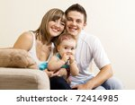 happy young parents with their... | Shutterstock . vector #72414985