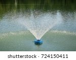 Small photo of Fountain aerator spray pattern to increase oxygen in the water