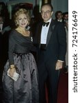 Small photo of Washington, DC. USA, 3rd December,1989 Andrea Mitchell of NBC along with her husband Alan Greenspan (Chairman of the Federal Reserve) arrive at the Kennedy Center to attend the annual Honors program.