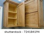 Stock photo wood kitchen cabinet with door open 724184194