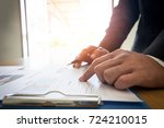 man hand with business report | Shutterstock . vector #724210015